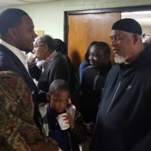 Councilman Basheer Jones and his son and Imam Abbas Ahmed of First Cleveland Mosque at Salaam Clinic Grand Opening